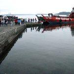 Muelle de Achao. Para llegar a Caguach las lanchas recogen a los devotos al amanecer.